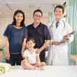 Happy family and pediatrician standing in the ward — Stock Photo #41772069