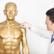 Chinese medicine doctor teaches acupoint on human model — Stock Photo #41772085
