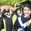 College graduate with happy classmates — Stock Photo #41889761