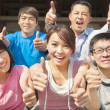 Stock Photo: Group of happy students with thumbs up