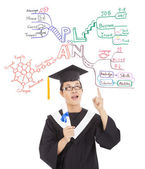 Graduate thinking out his future plan by mind mapping — Stock Photo