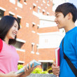 Stock Photo: Two students or friends are conversation happily