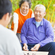 "Male seniors win a chinese board game .""weiqi"" — Stock Photo"