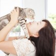 Pretty woman hug and kiss her cat — Stock Photo #42530017