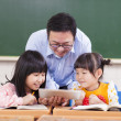 Teacher teaching children with digital tablet or ipad — Stock Photo