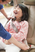Father take care daughter to fasten a seat belt — Stock Photo