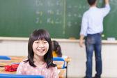 Happy schoolchildren looking at camera — Stock Photo