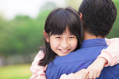 Beautiful little girl hugging embracing her father — Stock Photo