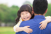 Happy little girl hugging embracing her father — Stock Photo