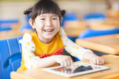 Smiling kid using tablet  or ipad — Стоковое фото