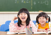 Cute smiling kids in the classroom — Stock Photo