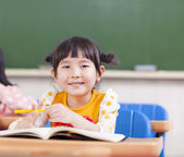 Cute children studying in a classroom — Stock Photo