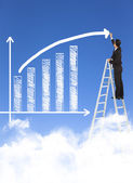 Business man writing growth bar chart with sky background — Stock Photo