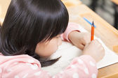 Student is focus on drawing his book — Stock Photo