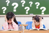 Two kids is full of questions in class — Stock Photo
