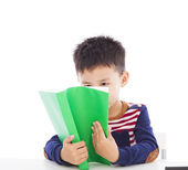 Asian kid reading a book — Stock Photo