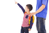 Little boy raise hand to point  with father — Stock Photo