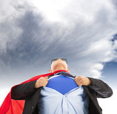 Businessman imitate superman to pull his t-shirt open  — Stock Photo