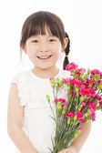 Close up of little girl holding  a bouquet of carnations — Stock Photo