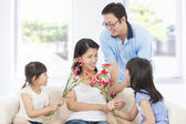 Daughters and father celebrating mother's day — Stock Photo