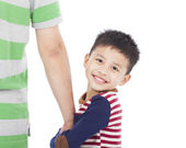 Happy little boy holding the hand of father — Stock Photo