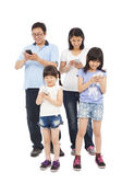Happy Family standing and using smart phone together — Stock Photo