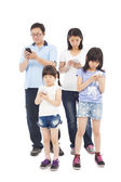 Asian Family standing and using smart phone together — Stock Photo