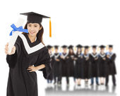 Young woman college graduate with students — Foto de Stock