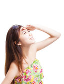 Young woman raising hand to cover sunlight  — Stock Photo