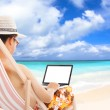Relaxed man sitting on beach chairs and using a laptop. — Stock Photo #46484003