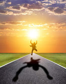 Business man running happily to successful road with sunset — Stock Photo