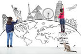 Two girl kids drawing global map and famous landmark  — Stock Photo