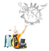 Young man is happy to watching his global travel plan — Stock Photo
