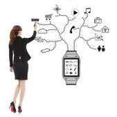 Business woman handwriting wearable watch applications  — Stock Photo