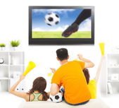 Young fans yelling  and while watching soccer game — Stock Photo