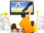 Young fans watching soccer game and yell at home — Stock Photo