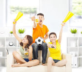 Young people shouting to encourage their  team  win at home — Stock Photo