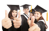 Happy group graduate students thumbs up together — Stock Photo