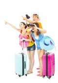 Happily young backpackers raise hands to point the direction — Stock Photo
