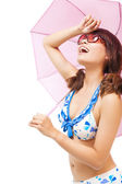 Young woman raise hand to cover sunlight with a umbrella — Stock Photo