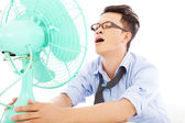 Business man  suffering a hot  summer heat with fans — Stock Photo