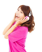 Happy young girl listening and holding the earphone — Stock Photo