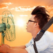 The heat wave is coming,business man holding a  electric fan — ストック写真 #48649139