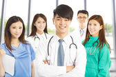 Professional medical doctor team standing over white background — Stock Photo