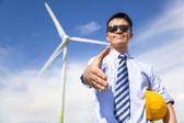 Business man handshake cooperate to do wind power fuel — Stok fotoğraf