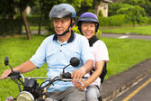 Senior couple drive motorcycle to travel — Stock Photo