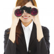 Attractive business woman with binoculars — Stock Photo #49068629