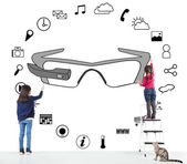 Kids drawing a wearable glasses applications chart — Stock Photo