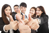 Happy successful business team with thumbs up — Stock Photo
