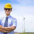 Confident  young engineer standing with wind generator — Stock Photo #49385953